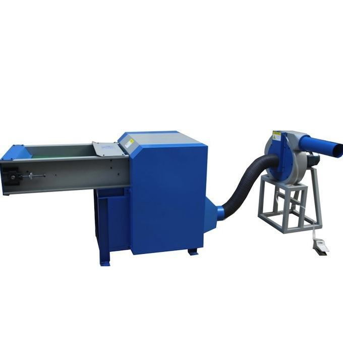 Fiber opening and pillow filling machine with single nozzle
